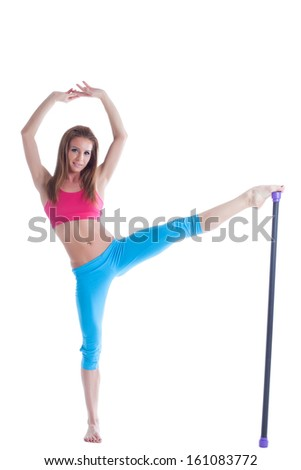 Attractive young fitness trainer isolated on white - stock photo