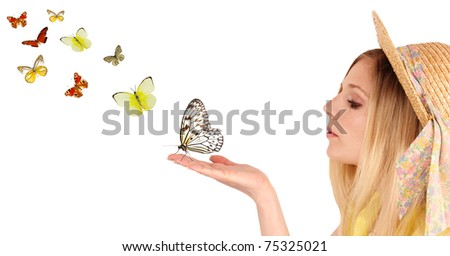 Attractive young girl blowing on butterflies.Isolated on white background - stock photo