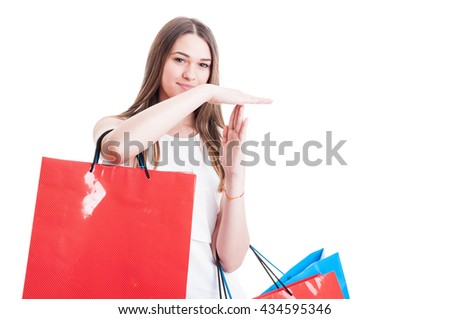 Attractive young girl making a timeout or stop sign as shopping break concept isolated on white with advertising area - stock photo