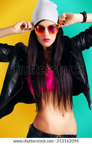 attractive young girl. modern casual style wear. sun glasses. sexual posing. fashion photo. - stock photo