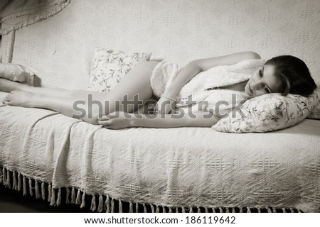 Attractive young girl on a sofa