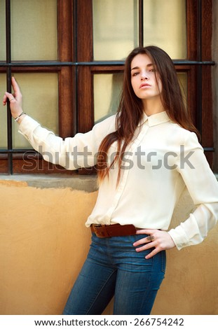 Attractive young girl posing on a city street summer day - stock photo