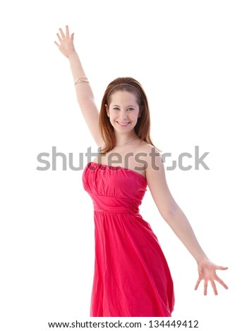 Attractive young girl smiling happily, wearing smart pink dress. - stock photo