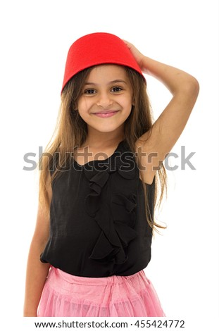 Attractive Young Girl With Beautiful Smile Wearing a Fez Isolated on White Background - stock photo