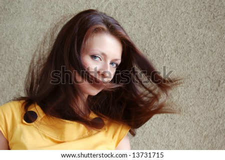 attractive young girl with flying hair