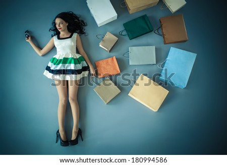 Attractive young girl with shopping bags - stock photo