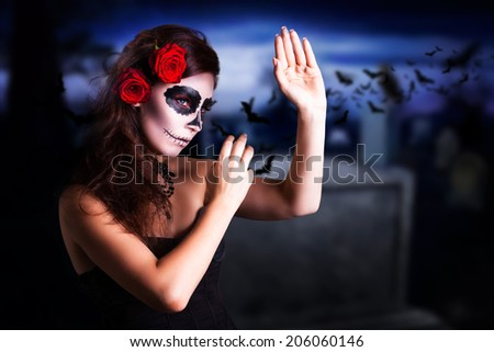 attractive young girl with sugar skull styling - stock photo