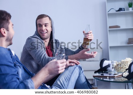 Attractive young guys are enjoying alcohol drink - stock photo