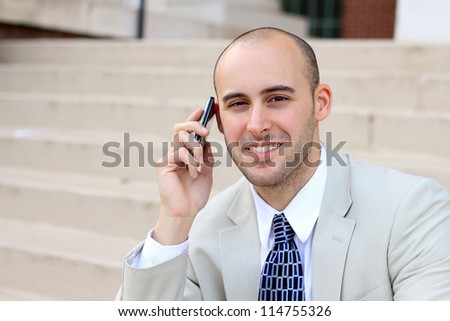 Attractive, Young Happy and Smiling Professional Business Man Talking on the Phone