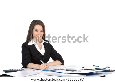 Attractive young happy smiling businesswoman in elegant suit sitting at the table, desk, working with documents, write, sign up contract, paper, business plan. isolated over white background