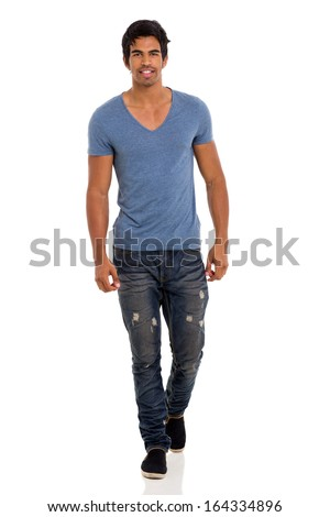 attractive young indian man walking towards the camera on white - stock photo