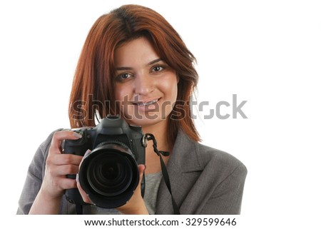 Attractive young Indian woman with a high end DSLR - stock photo