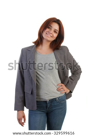 Attractive young Indian woman with jacket and jeans - stock photo