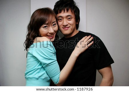 Attractive young Korean couple - stock photo
