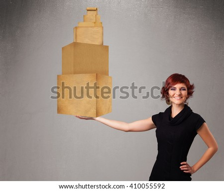 Attractive young lady holding a set of brown cardboard boxes - stock photo