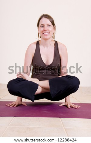 Attractive young lady yoga pendant pose stock photo 12288424 attractive young lady in the yoga pendant pose lolasana mozeypictures Image collections