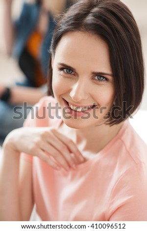 Attractive young lady is working with joy - stock photo