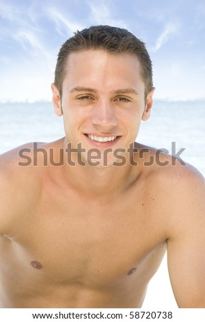 Attractive young man at the beach