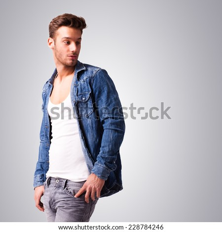 attractive young man in casual clothes - stock photo