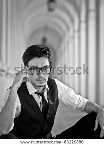 attractive young man in elegant eyeglass in bw retro style - stock photo