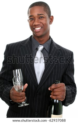 Attractive young man in stylish pinstripe suit with Champagne and glasses over white background.