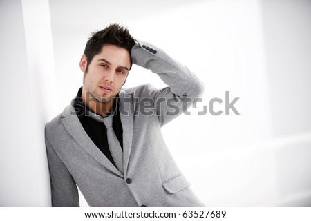 Attractive young man in urban and modern background - stock photo