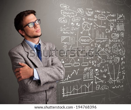 Attractive young man looking at stock market graphs and symbols - stock photo