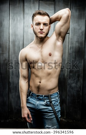 Attractive young Man posing wearing jeans - stock photo
