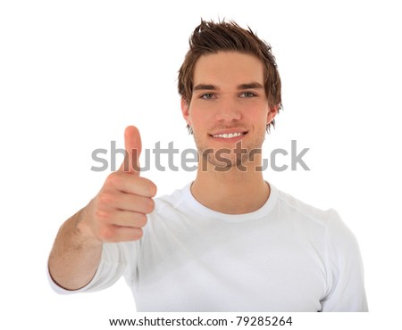 Attractive young man showing thumbs up. All on white background. - stock photo