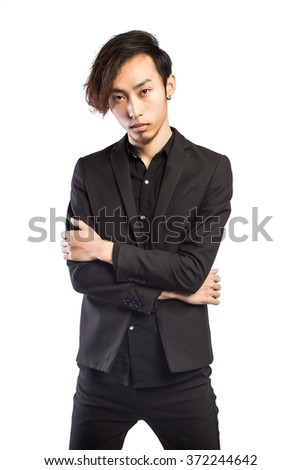 Attractive Young Man wearing a suit isolated on white. - stock photo