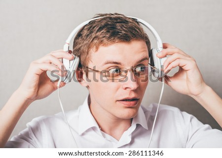 Attractive young man wearing headphones  - stock photo