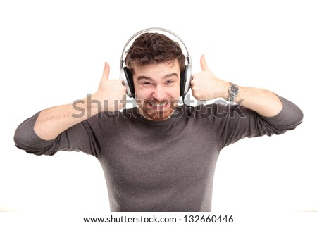 Attractive young man wearing headphones on white background - stock photo