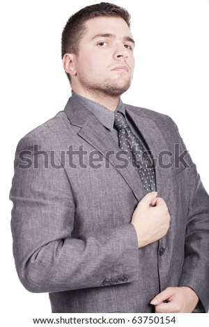 attractive young man with a grey suit and a tie posing - stock photo