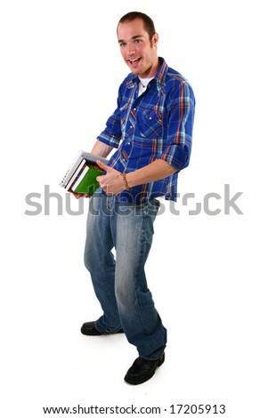 Attractive young man with laptop and books standing.