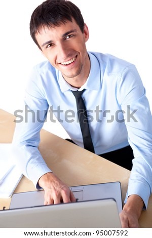 Attractive young man working with a laptop at his office