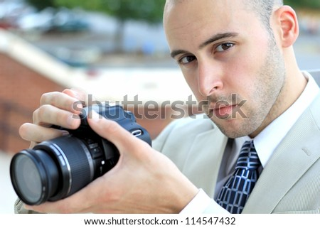 Attractive, Young Mature Professional Photographer Business Man Serious While Taking a Picture