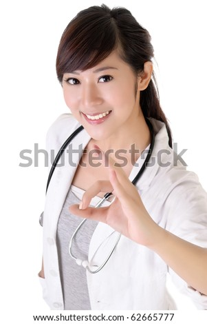 Attractive young medical doctor woman give ok gesture with smiling. - stock photo