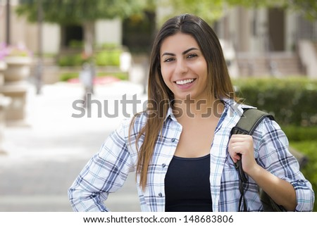 Attractive Young Mixed Race Female Student Portrait on School Campus with Backpack. - stock photo