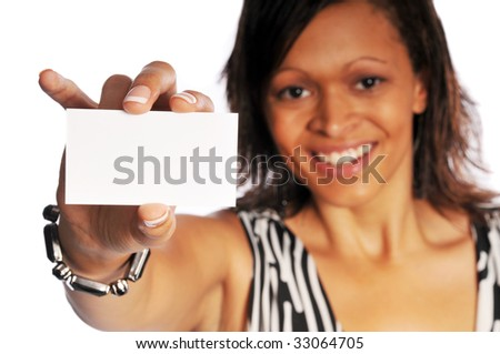 attractive young model posing on a white background holding a business card