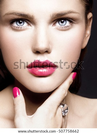 attractive young model with bright make-up and manicure. close up portrait