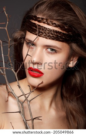 attractive young model with red lips and bright make-up black background