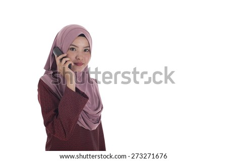 Attractive young muslimah businesswoman talking on the phone. - stock photo