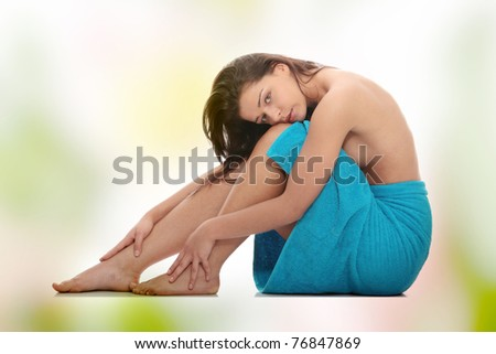 Attractive young nude woman getting ready for spa treatment - stock photo