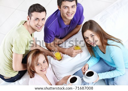 Attractive young people drinking - stock photo