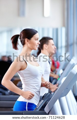 Attractive young people engaged in fitness - stock photo