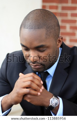 Attractive, Young Professional African American Businessman Praying