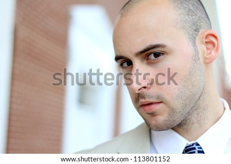 Attractive, Young Professional Business Man Who is  Mature and Serious - stock photo