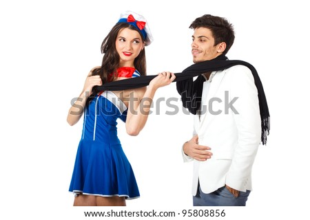 Attractive young sailor woman seducing elegant man. Isolated on white background. High resolution studio image