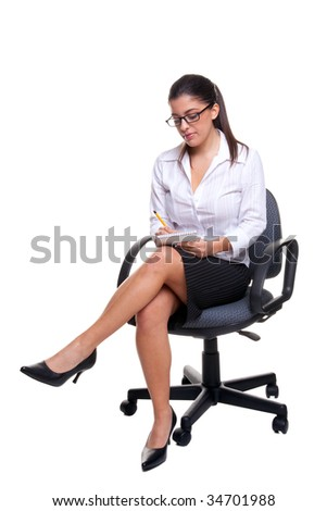 Attractive young secretary sat on an office chair taking notes, isolated on a white background. - stock photo