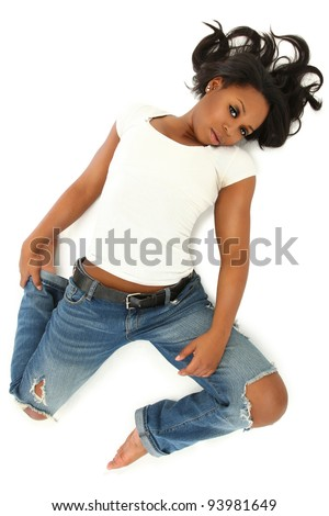 Attractive Young Sexy Black Woman in Jeans and Shirt Laying on White Floor - stock photo